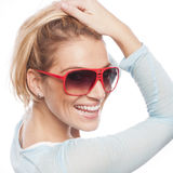 Cheerful female. Smiling cheerful female with shades posing in a close up portrait Stock Photo