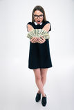 Cheerful female student holding dollar bills Royalty Free Stock Photography