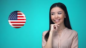 Cheerful female student pushing USA flag button, ready to learn foreign language. Stock footage stock video footage