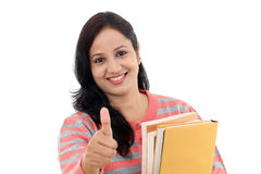 Cheerful female student with thumbs up gesture Stock Photography