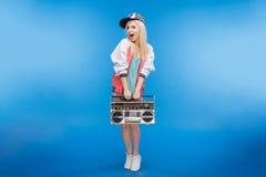 Cheerful Female Teenager Holding Retro Boom Box Royalty Free Stock Image