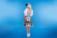 Cheerful female teenager holding retro boom box Royalty Free Stock Image