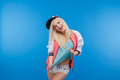 Cheerful female teenager. Posing on blue background royalty free stock image