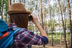 Cheerful female tourist enjoying the scenery stock photography