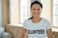 Cheerful female volunteer performing community service Stock Photos
