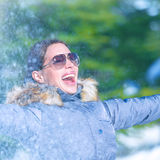 Cheerful female in winter park Royalty Free Stock Photo