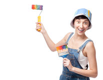 Cheerful female worker holding brush Stock Image