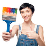 Cheerful female worker holding brush Royalty Free Stock Image