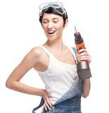 Cheerful female worker holding drill Stock Photo