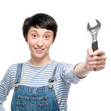 Cheerful female worker holding wrench Royalty Free Stock Images