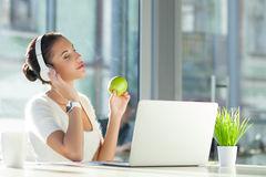 Cheerful female worker is relaxing at work Stock Images