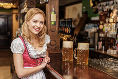 Cheerful female working at boozer Stock Images
