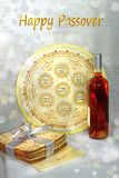 Cheerful festival of Passover and its attributes. Spring holiday of Passover and its attributes, with bottle of wine, seder plate, matzo and Haggadah in Hebrew royalty free stock photos