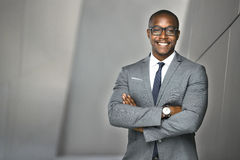 Cheerful financial executive business man stock investor standing tall and proud Stock Photos