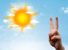 Cheerful finger smileys with bright sun and clouds illustration Stock Photos