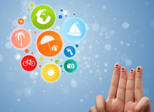 Cheerful finger smileys with colorful holiday travel bubble icon Royalty Free Stock Photography
