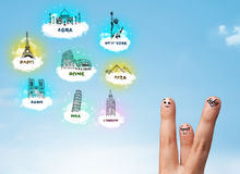 Cheerful finger smileys with sightseeing landmarks icons Stock Image