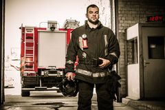 Cheerful firefighter near truck Royalty Free Stock Photography