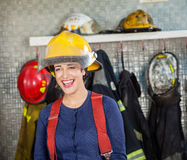 Cheerful Firewoman At Fire Station Royalty Free Stock Photography