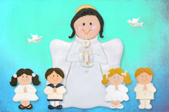 Cheerful first communion card, angel with children. Of sugar on colorful background Stock Image