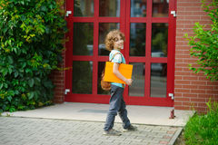 Cheerful first grader coming to the school door. Stock Photography