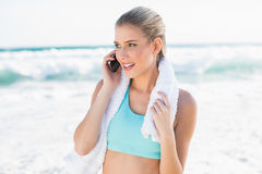 Cheerful fit blonde in sportswear on the phone Stock Photo