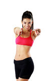 Cheerful fit woman pointing at you Stock Photos