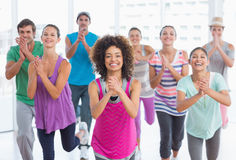 Cheerful fitness class and instructor doing pilates exercise Royalty Free Stock Images