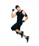 Cheerful fitness man jumping Royalty Free Stock Image