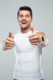 Cheerful fitness man showing thumb up Stock Photography