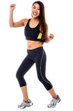 Cheerful fitness trainer dancing in joy Royalty Free Stock Photography