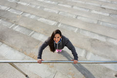 Cheerful fitness woman doing push ups workout Stock Photography