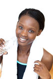 Cheerful fitness woman drinking water Stock Photography