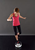 Cheerful fitness woman on scale Stock Photo