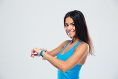 Cheerful fitness woman using fitness tracker Stock Photography