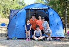 Cheerful five-person family with three children with camping ten Royalty Free Stock Photos