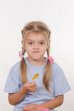 Cheerful five year girl with sweet candy in hands of Royalty Free Stock Photography