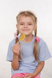 Cheerful five year old girl with a lollipop Stock Photography