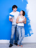 Cheerful flirting couple of painters Stock Photos