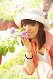 Cheerful Florist with Flowers Royalty Free Stock Image
