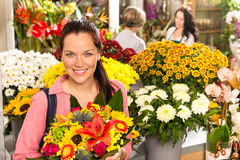 Cheerful florist woman showing colorful flowers market Stock Photography