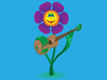 Cheerful flower plays music on the guitar Stock Images