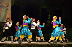Cheerful folklore dancers group enjoying on scene Stock Image