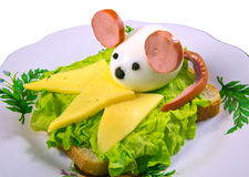 Cheerful food. The mouse made of egg on a bed of lettuce, cheese Royalty Free Stock Photography