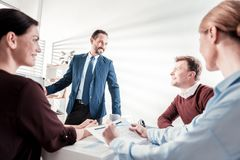 Cheerful four colleagues cooperating royalty free stock photography