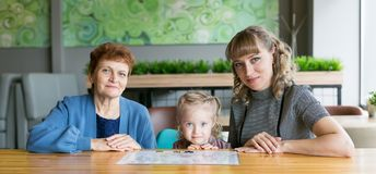 Cheerful friendly family of three women. stock images
