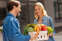 Cheerful friendly woman picking up her groceries Stock Photography