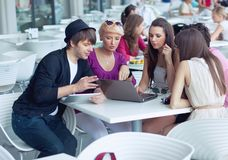 Cheerful friends. Browsing internet in a restaurant Stock Images