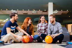 Cheerful friends bowling together Stock Photography