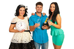 Cheerful friends celebrate New Year Stock Photos